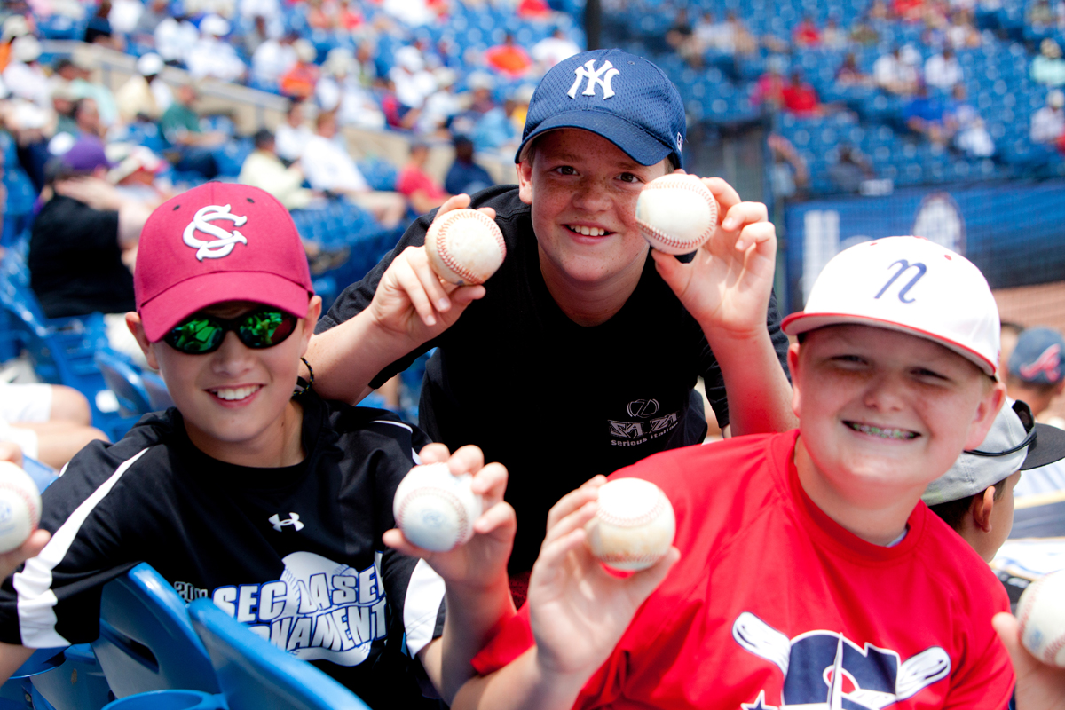 kids with baseballs